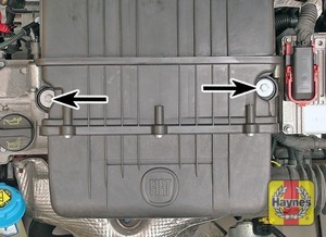 Illustration of step:  Undo the bolt each side (arrowed) and lift the air cleaner housing upwards a little  - Euro 5 emissions level - step 9