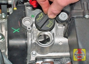 Illustration of step:  Oil is added through the filler cap - Car care - step 11