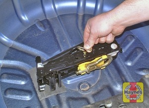 Illustration of step:  Unscrew the retaining bolt, and lift the spare wheel out - Changing the wheel - step 3