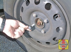 Illustration of step:  Unscrew the wheel nuts, noting which way round they fit (tapered side inwards), and remove the wheel - Changing the wheel - step 7