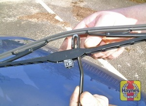 Illustration of step:  To remove a windscreen wiper blade, pull the arm fully away from the glass until it locks - step 4