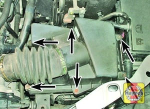Illustration of step:  Undo the filter cover bolts (arrowed)  - 1.8 and 2.0 litre models - step 14