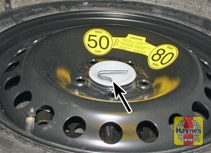 Illustration of step:  The spare wheel and tools are stored under the floor in the luggage compartment - Changing the wheel - step 2