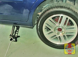 Illustration of step:  Two jacking points are provided on each side – use the one nearest the punctured wheel - Changing the wheel - step 5