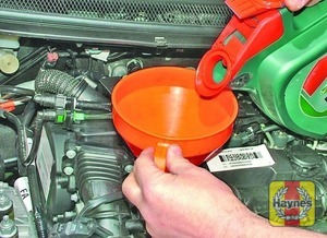 Illustration of step:  Add the oil slowly, checking the level on the dipstick often, and allowing time for the oil to run to the sump - Car care - step 13