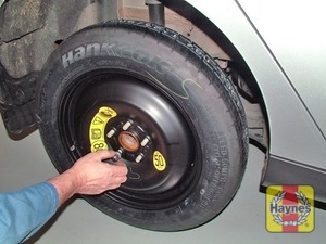 Illustration of step:  Fit the spare wheel, and screw on the nuts - step 7