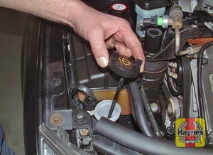Illustration of step:  The screen washer fluid reservoir filler neck is located in the right-hand front corner of the engine compartment, behind the headlight - Screen wash fluid level - step 24