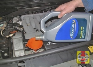 Illustration of step:  Oil is added through the filler cap, located on top of the engine, towards the rear on all except V6 engines - Car care - step 13