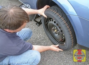 Illustration of step:  Fit the spare wheel, and screw on the nuts - Changing the wheel - step 7