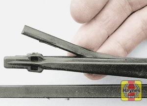 Illustration of step:  Check the condition of the wiper blades; if they are cracked or show any signs of deterioration, or if the glass swept area is smeared, renew them - step 1