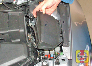 Illustration of step: Unclip the cover from the fusebox on the left-hand side of the engine compartment - step 1