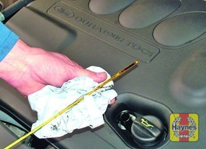 Illustration of step:  Using a clean rag or paper towel remove all oil from the dipstick - Car care - step 13