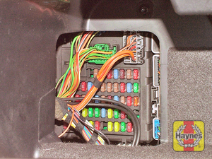Illustration of step: Open the glovebox and unclip the cover to access the main fusebox - step 1