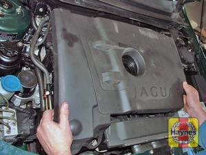Illustration of step:  Remove the engine oil level dipstick and pull the plastic cover upwards from the engine  - step 2