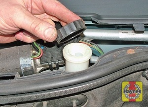 Illustration of step:  If topping-up is necessary, wipe the area around the filler cap with a clean rag, then unscrew the cap - Safety first! - step 30