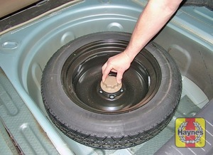 Illustration of step:  The spare wheel and tools are located in the luggage compartment, under the boot carpet - step 2