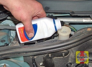 Illustration of step:  Carefully add fluid, avoiding spilling it on surrounding paintwork - Safety first! - step 31