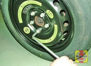Illustration of step:  Securely tighten the wheel bolts in a diagonal sequence and then (where applicable), refit the wheel trim - step 10