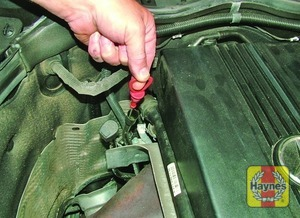 Illustration of step:  On models with a dipstick fitted, the dipstick cap is coloured red for easy identification (see Underbonnet check points for exact location) - Car care - step 13