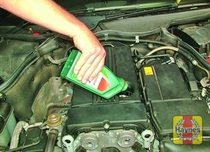 Illustration of step:  Unscrew the cap and place some cloth rags around the filler cap aperture, then top-up the level - Car care - step 15