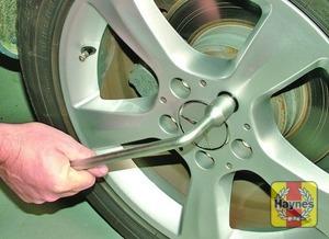 Illustration of step:  Use the wheelbrace to slacken each wheel bolt by half a turn - step 5