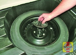 Illustration of step:  Unscrew the plastic retainer and remove the spare wheel - step 6