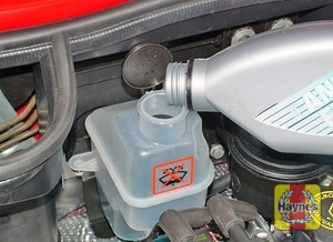 Illustration of step:  Add a mixture of water and antifreeze to the overflow tank until the level of the coolant is just below the MAX mark on the overflow tank - Car Care - step 13