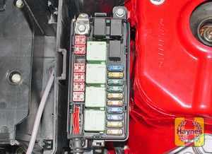 Illustration of step: Early model auxiliary fusebox is mounted on the left-hand side of the engine compartment - step 3