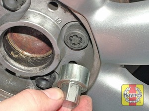 Illustration of step:  If anti-theft wheel bolts are fitted, slacken them using the adapter supplied in the tool kit - step 4