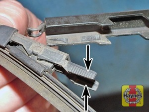 Illustration of step:  To remove a rear wiper blade, pull the arm away from the screen, squeeze together the catches, swing the blade out, and remove the blade from the catch - step 3
