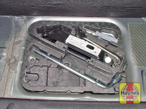 Illustration of step:  The spare wheel is stored in under the floor of the luggage compartment - step 2