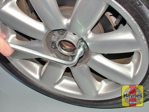 Illustration of step:  Securely tighten the wheel bolts in a diagonal pattern then refit the wheel trim/hub cap (as applicable) - step 7