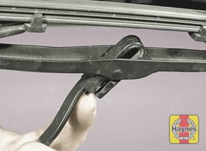 Illustration of step: To remove a windscreen wiper blade pull the arm fully away from the glass until it locks - step 2