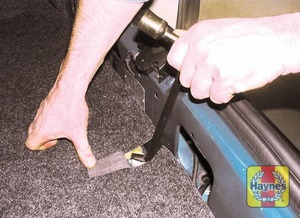 Illustration of step: Unclip the wheelbrace from its holder at the rear of the luggage compartment - step 3