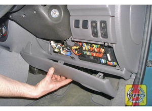 Illustration of step: The main fusebox is located underneath the lower cover on the driver's side of the fascia - step 1