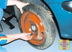 Illustration of step: Remove the bolts and lift off the wheel - step 7