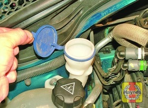 Illustration of step:  The screen washer fluid reservoir filler neck is located in the right-hand side of the engine compartment, behind the coolant reservoir - Washer fluid level - step 33