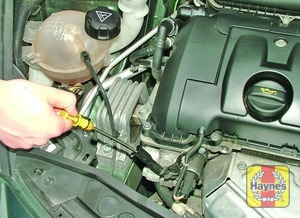 Illustration of step:  The engine oil level is checked with a dipstick that extends through the dipstick tube and into the sump at the bottom of the engine - Car care - step 11
