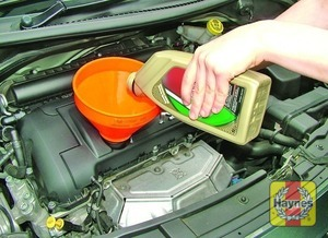 Illustration of step:  Oil is added to the engine via the filler cap on the cylinder head cover - Car care - step 14
