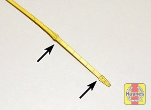 Illustration of step:  Note the oil level on the end of the dipstick, which should be between the upper (MAX) mark and lower (MIN) mark - Car Care - step 7