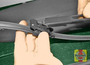 Illustration of step:  Tilt the wiper blade and unhook it from the end of the arm, taking care not to allow the arm to damage the windscreen - step 5
