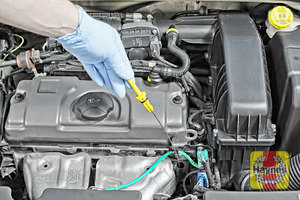 Illustration of step: Remove dipstick and place the vacuum extractor pipe down the dipstick tube - step 1