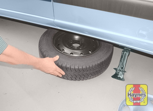 Illustration of step:  Raise the jack until the wheel is clear of the ground, then unscrew the wheel bolts and remove the wheel - step 9