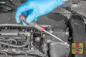 Illustration of step: Undo the circular clip on the air intake - use a 7mm socket or a screwdriver - step 4