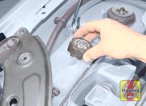 Illustration of step:  Unscrew the expansion tank filler cap  - Car Care - step 24