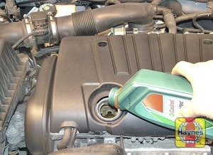 Illustration of step:  Oil is added through the filler cap - Car care - step 15
