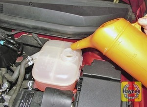 Illustration of step:  Add a mixture of water and antifreeze to the expansion tank until the coolant is up to the KALT/COLD level mark - Car care - step 21