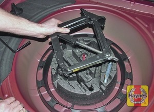 Illustration of step:  Remove the tools from the carrier stored beneath the spare wheel - step 3