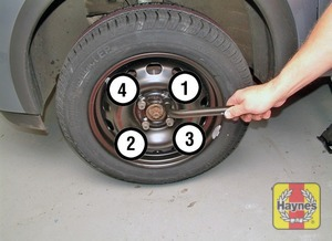 Illustration of step:  Securely tighten the wheel bolts in a diagonal sequence then refit the wheel trim - step 7