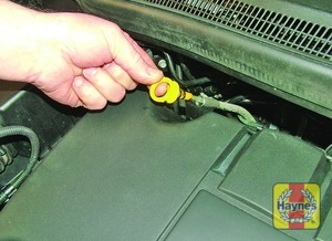 Illustration of step:  The dipstick is brightly coloured for easy identification (see Underbonnet check points for exact location) - Car care - step 10